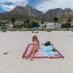 Tegan on the beach, table mountain behind