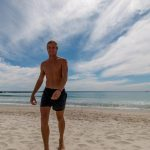 Dan walking back from a freezing swim