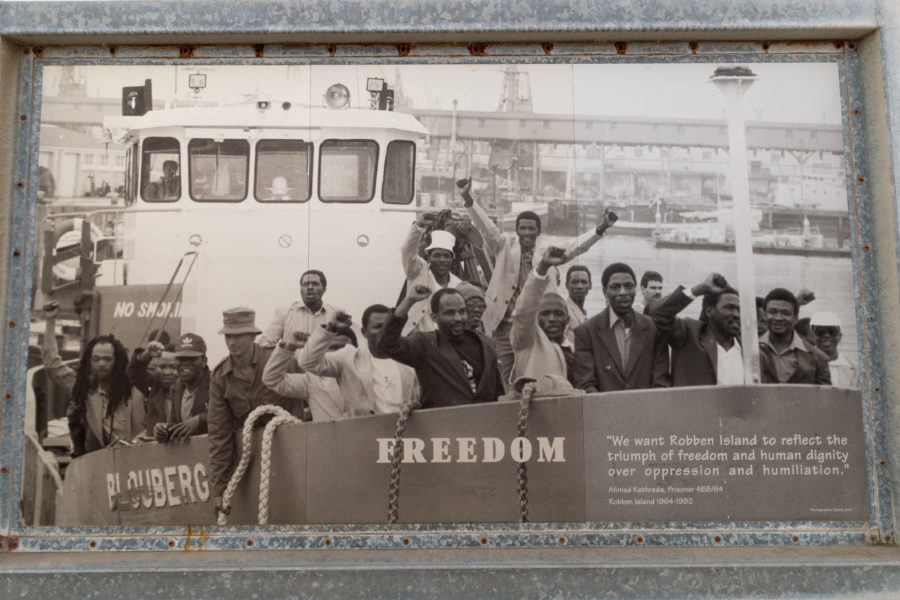 Picture of a sign with a picture on it of the prisoners leaving