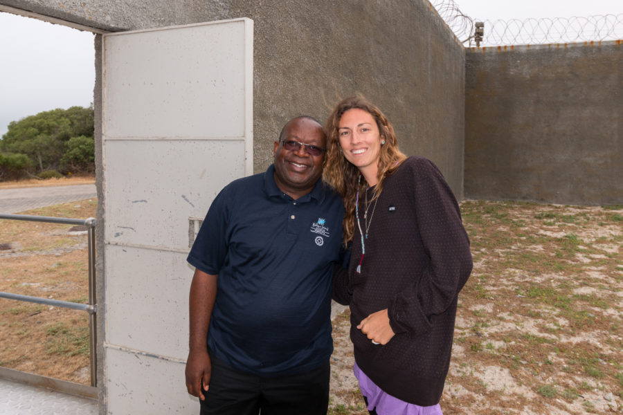Tegs standing with a former inmate!