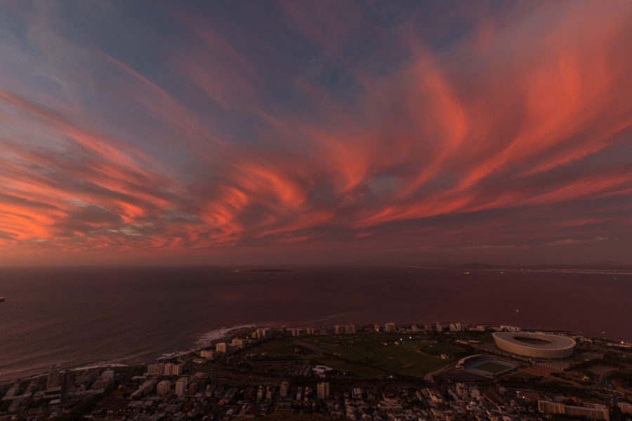 fluffy pink and orange clouds from the lookout at Lions head