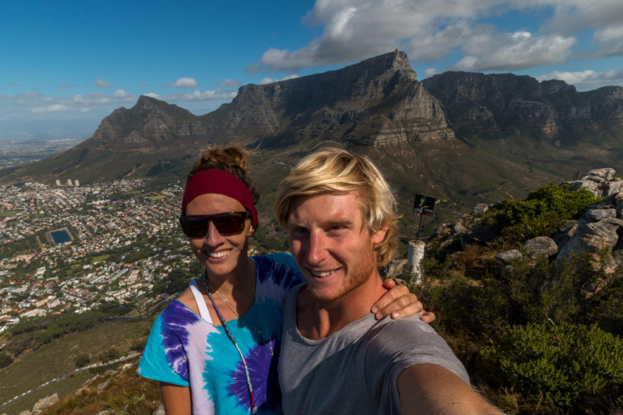 Couple shot on top of Lions head, table mountain in the background