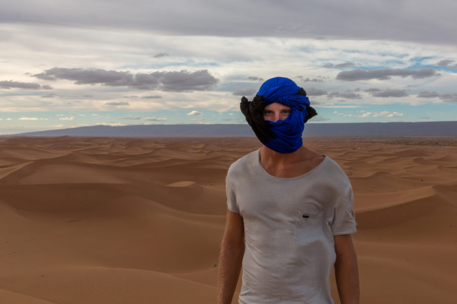 Dan in the dunes with his headscarf on