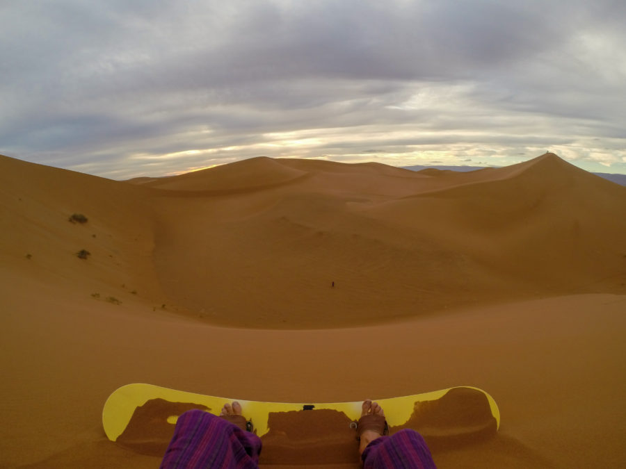Dans view from the top of the dune, feet strapped in to the sandboard