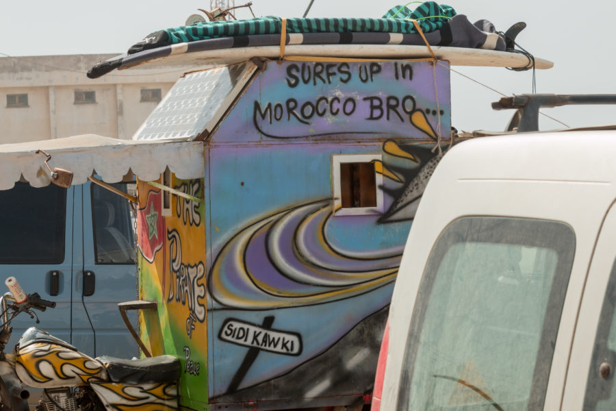 Awesome camper spray painted with Surfs Up in Morocco Bro