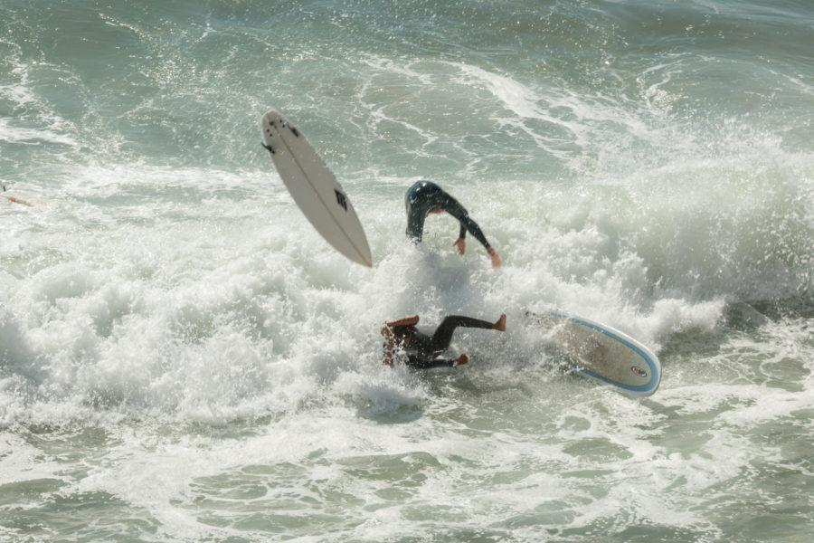 Dan mid air after colliding with a local on a wave