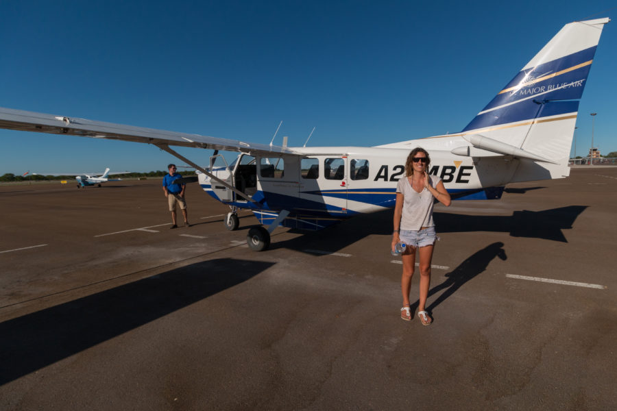 Tegan standing next to our 6 seater plane for our scenic flight
