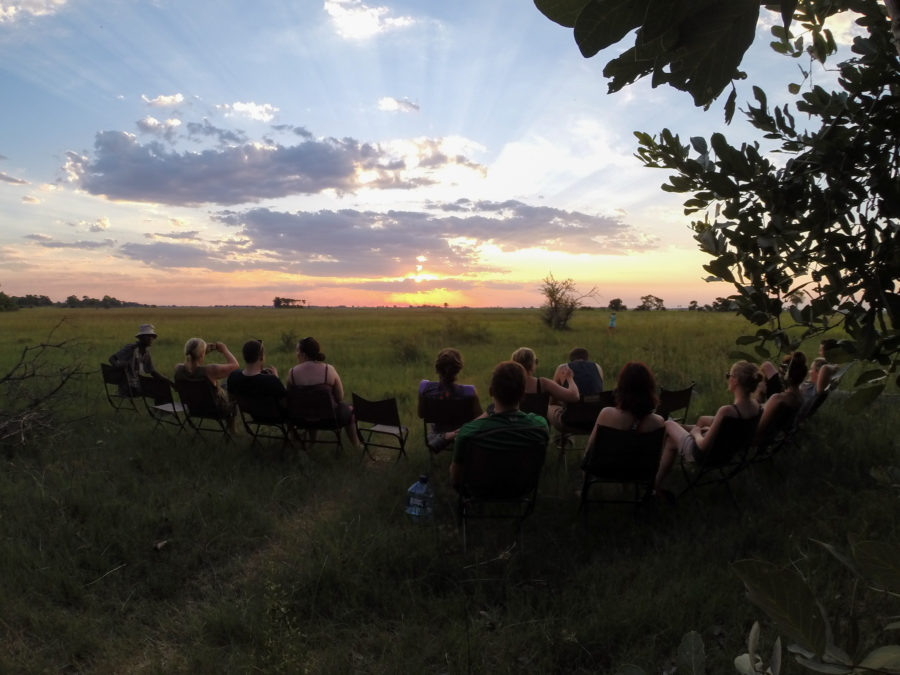 Tour group sitting out watching the sunset over the delta