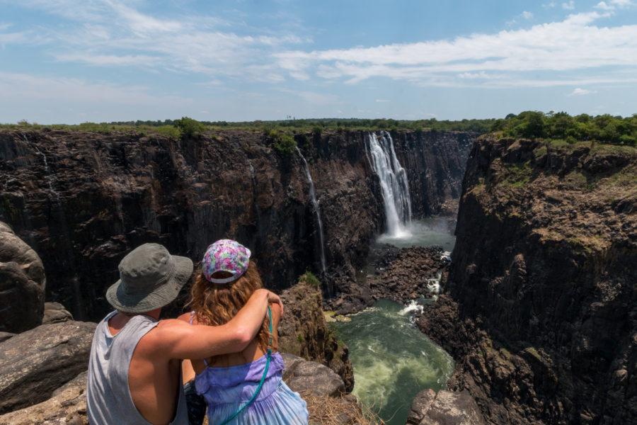 Us sitting on the edge admiring the falls