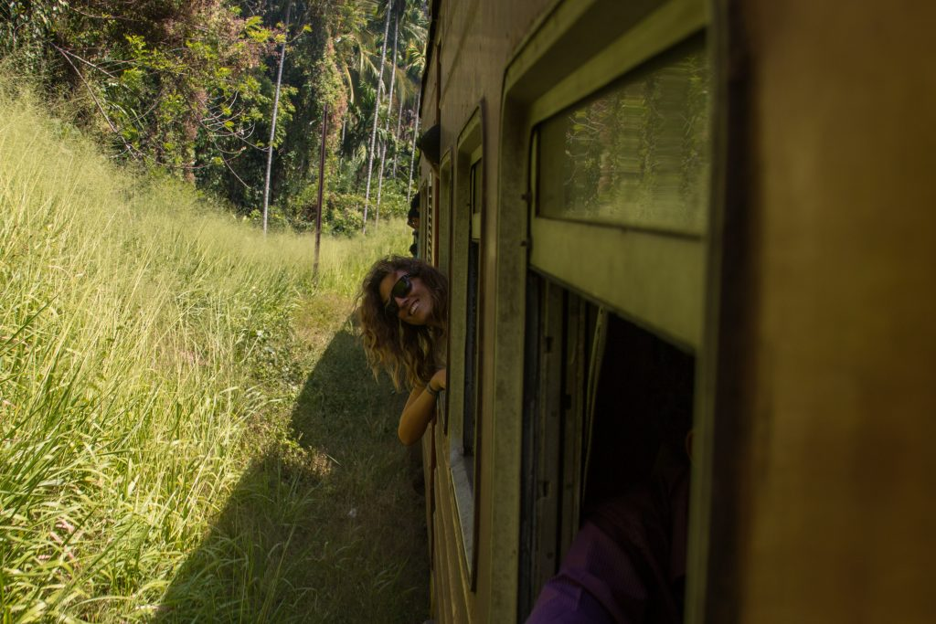 Tegs poking her head out the train