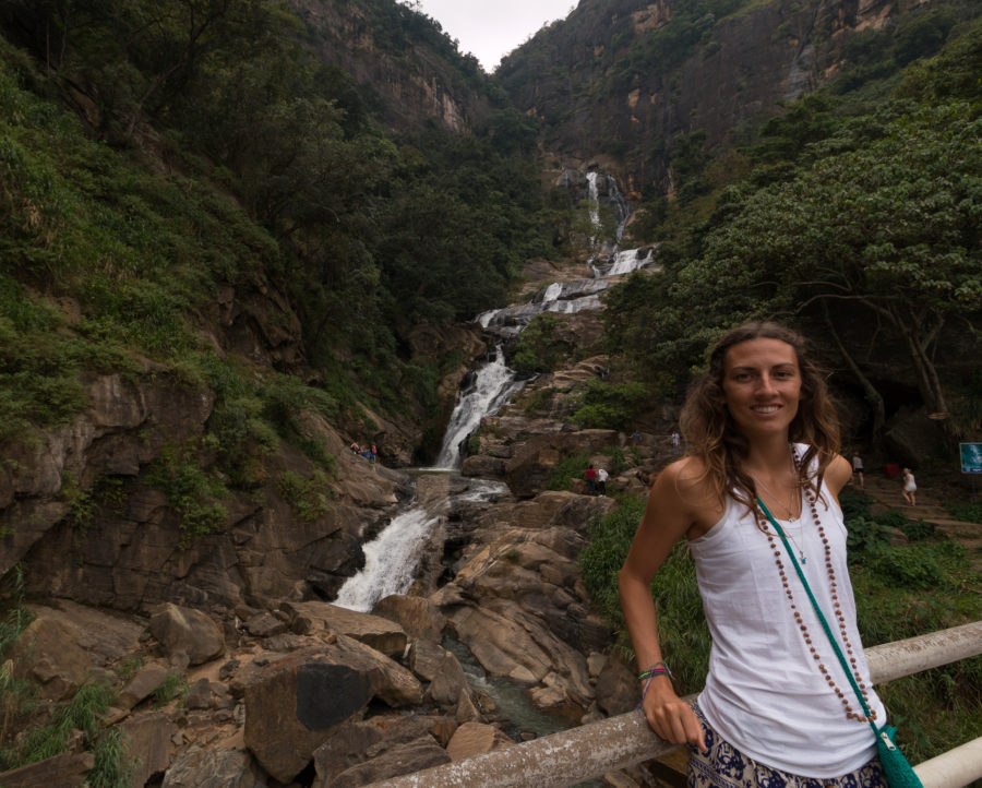 Tegs standing in front of the waterfall