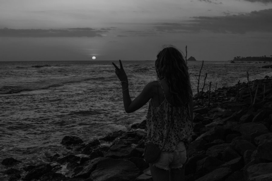 Black and white pic of Tegan and the sun set over the sea