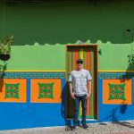 Dan leaning against the colourful walls