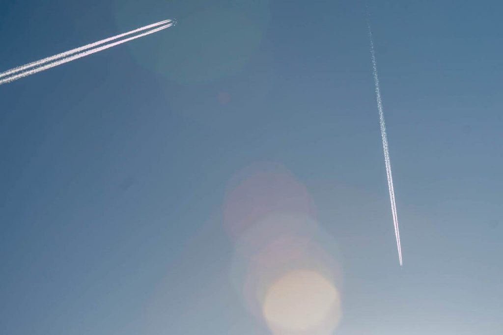 Jet streams across a blue sky somewhere in Europe