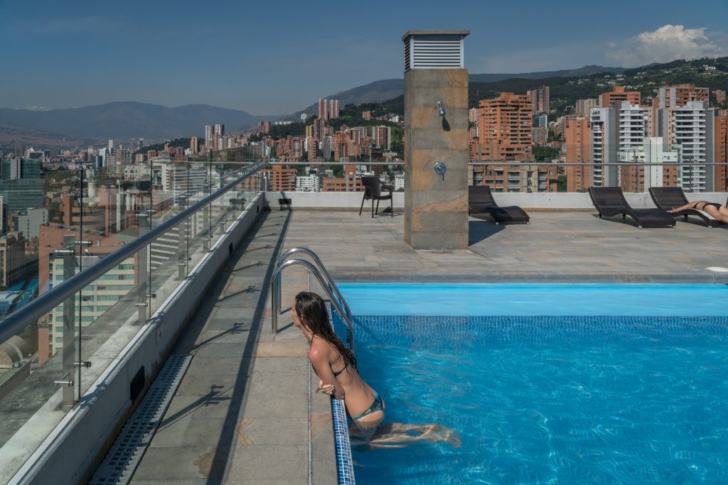 Tegan in the pool looking out over the city